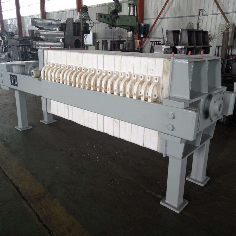 Plate and frame filter press for sludge treatment